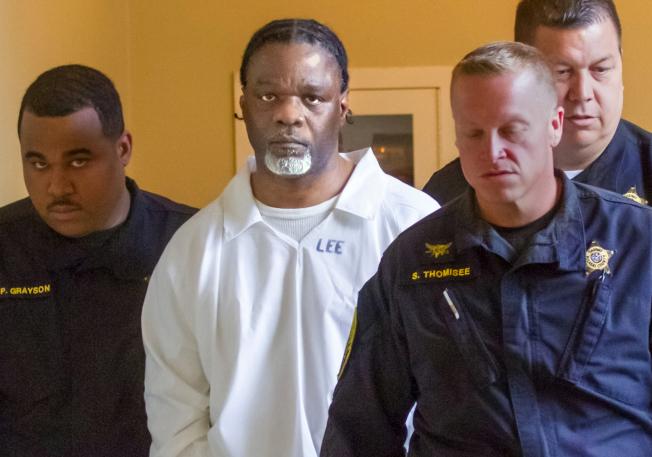 51歲的李伊(中)被執行死刑。(美聯社)