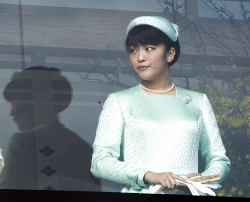 FILE - In this Dec. 23, 2011, file photo, Japan's Princess Mako stands on a bulletproofed balcony at the Imperial Palace in Tokyo to greet well-wishers who throng to the palace compound to celebrate Emperor Akihito's 78th birthday. Mako, the granddaughter of Emperor Akihito, is getting married to an ocean lover who can ski, play the violin and cook, according to public broadcaster NHK TV. The Imperial Household Agency declined to confirm the report Tuesday, May 16, 2017. (AP Photo/Koji Sasahara, File)