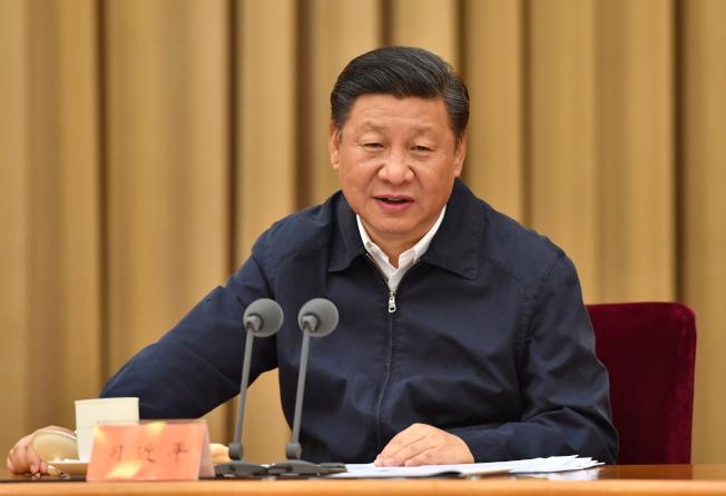 習近平主持14日到15日在北京舉行的中國全國金融工作會議併發表重要講話。(新華社)
