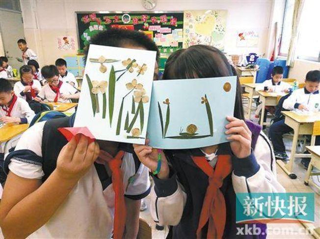 越秀区中山三路小学课后班同学在学习做手工。(取材自新快报/受访者供图)