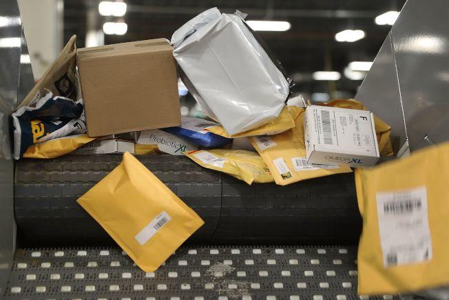 川普扬言退出万国邮政联盟,意在取消中国享有的优惠。 Getty Images