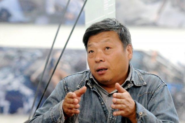 用镜头揭露中国环境污染问题的自由摄影师卢广,证实遭中国警方逮捕。 (路透)