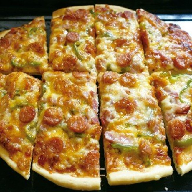 加了大量乳酪丝的披萨,冷了也愈嚼愈香。图/太阳脸