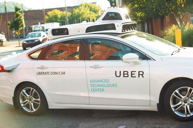 Uber自駕車駛過街頭,由於表現不如預期,要安全載客上路還有很長的路要走。(Getty Images)