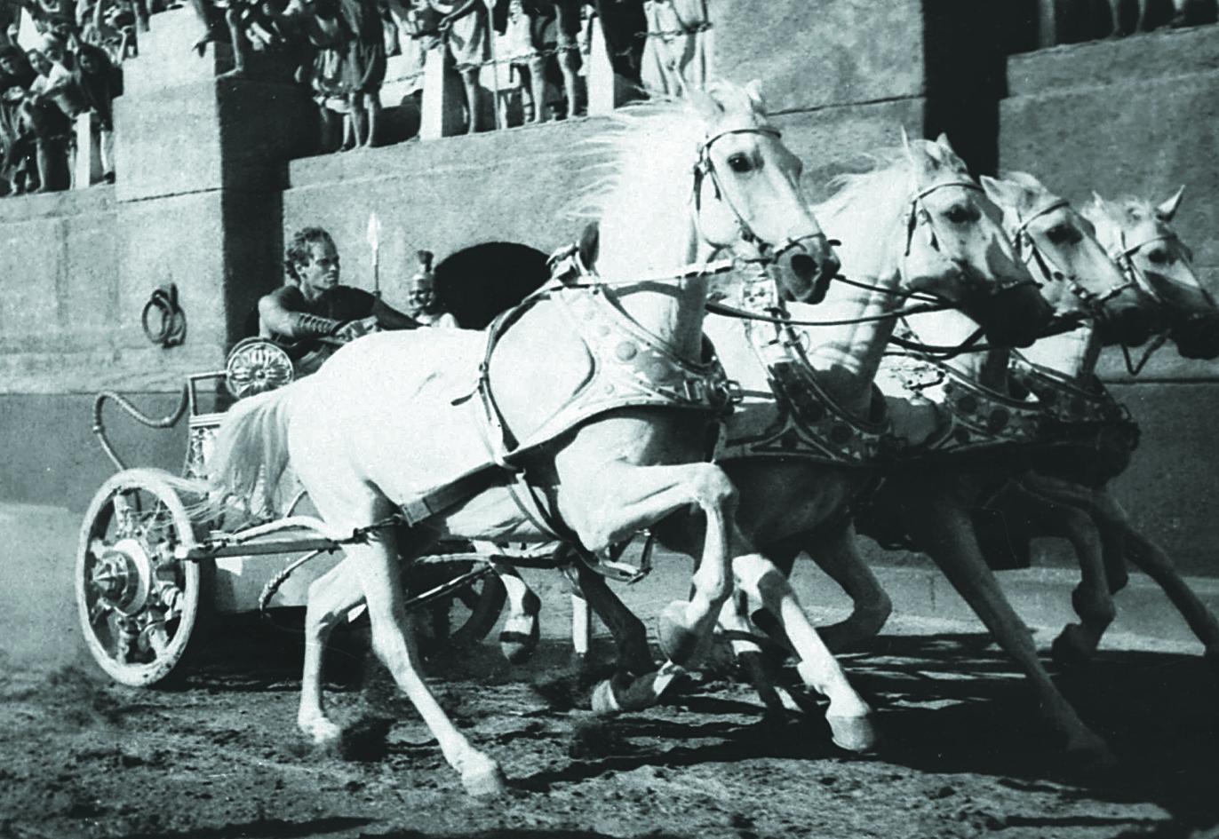 卻爾登希斯頓在1959年主演名片「賓漢」中駕馭馬車的經典畫面。(美聯社)