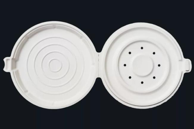 蘋果員工餐廳的披薩盒有著全白外型,圓形的外殼還打了數個小孔。(取材自Verge)