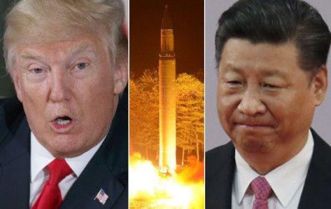 中國11日對關島核危表態,對美國回手,採取中立。(路透、美聯社)