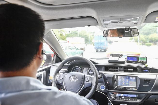 在廣州,有近四萬出租車司機每天活躍在大街小巷。(中新社)
