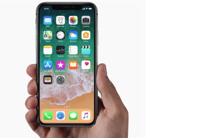 iPhone X擁有5.8吋OLED大螢幕,並取消實體Home鍵。圖/摘自蘋果官網