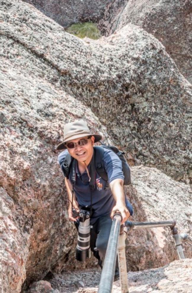 Jason熱愛爬山與攝影。(取自網站)