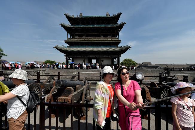 平遙古城2016年接待國內外遊客上千萬人次。(新華社資料照片)