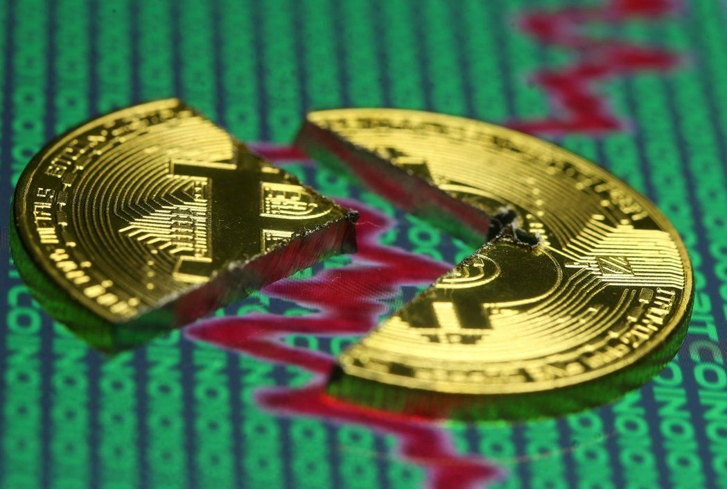 南韓當局有意遏制加密貨幣投機風潮,比特幣28日跌破14,000美元。(路透)