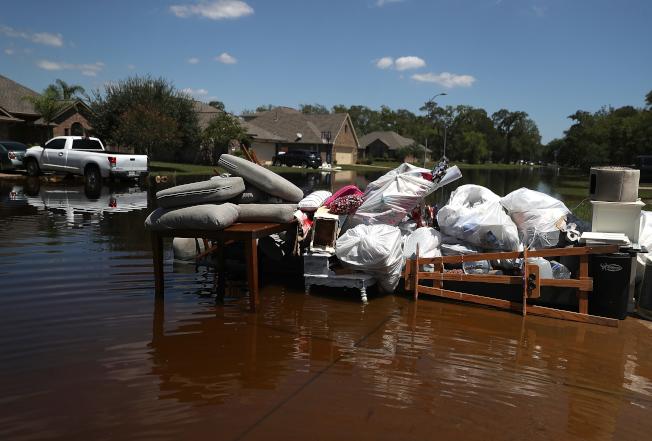 圖為德州哈維颶風災區。(Getty Images)