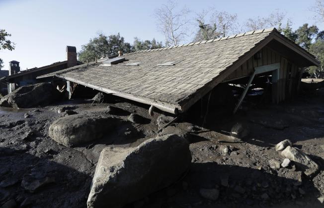 一幢房屋被土石流「夷為平地」。(美聯社)