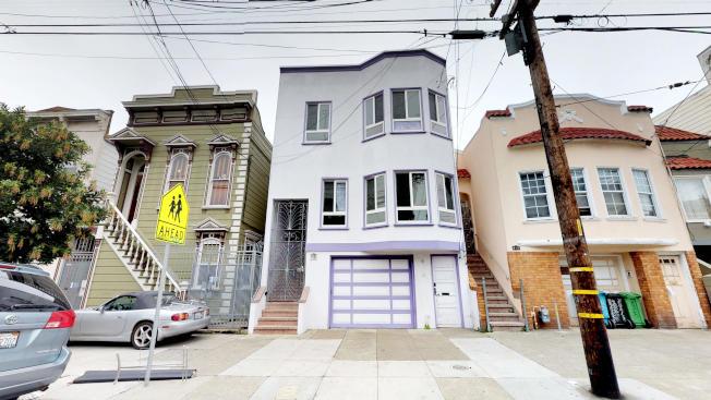 這棟雙併建築位於熱鬧的米慎區。