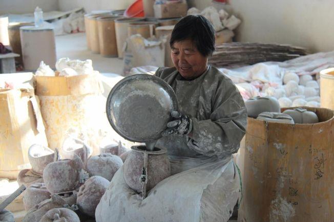 全村从事金蛋生产的就有2000馀人,占总人口约75%。(取材自环球网/视觉中国图)