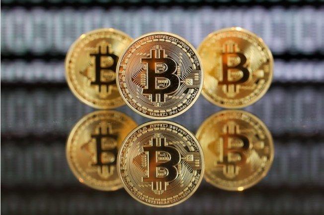 比特幣近十年前由一個電腦程式員創造出來,並沒有實體,也不是政府發行。(Getty Images)