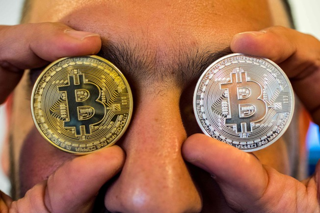 許多人希望藉投資比特幣一舉致富。(Getty Images)