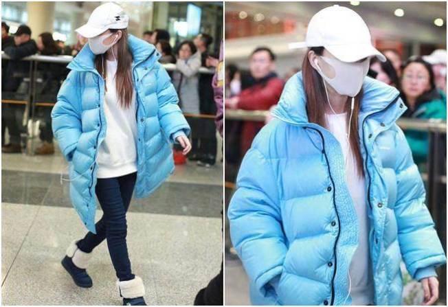 李小璐近日現身機場,戴著帽子及口罩,拒絕回答關於婚變的所有話題。(取材自微博)