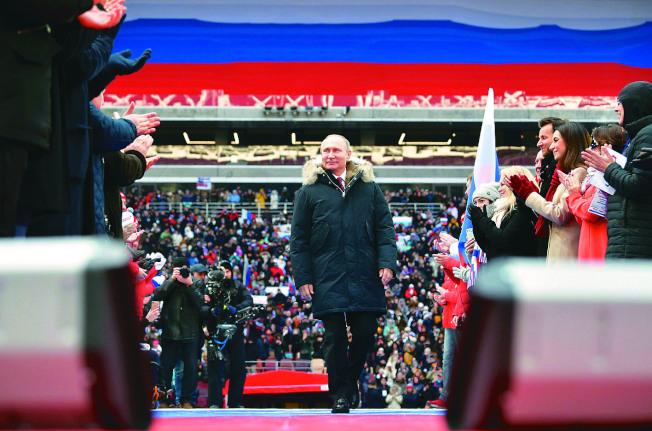 俄羅斯18日舉行總統大選,預料普亭將輕鬆連任。(路透)