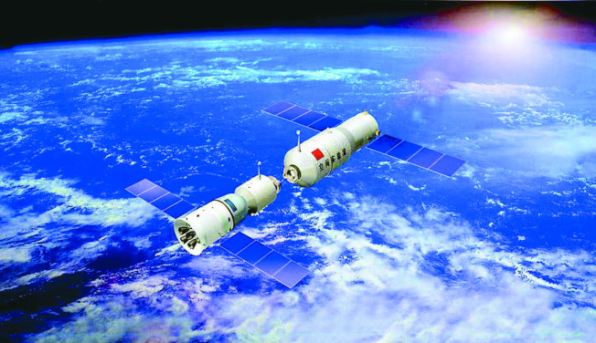 天宮一號2013年與神舟九號成功完成對接。(新華社)