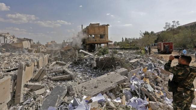 敘利亞官方15日公布的照片顯示被美英法聯軍摧毀的建築。(TNS)