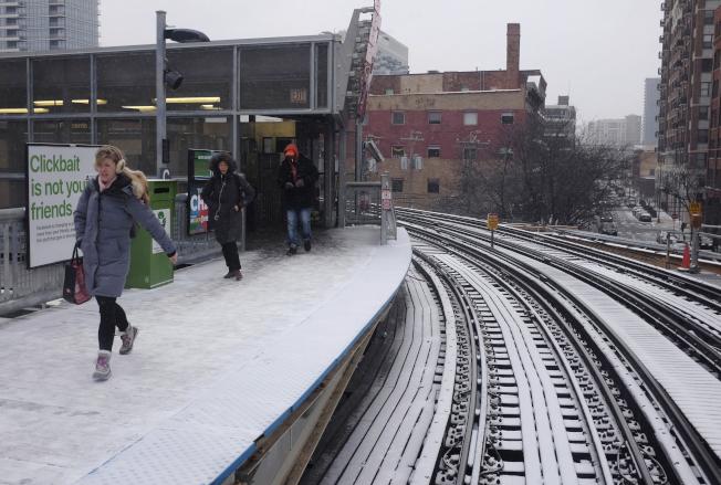 圖為芝加哥16日降雪。美聯社