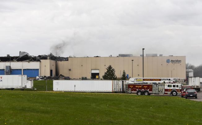 当福特团队进入Meridian工厂时,它仍然在冒烟。(美联社)