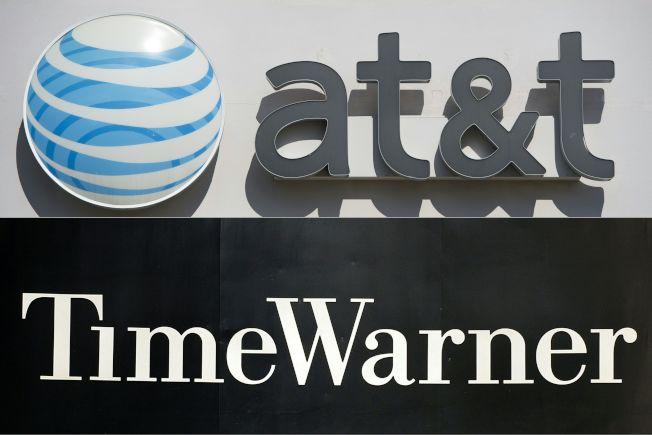 聯邦政府以反壟斷條款反對AT&T併購「時代華納」之舉,12日遭到法院否決。(美聯社)