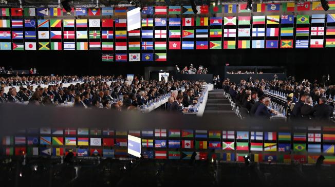 在俄羅斯世足賽開幕前夕,國際足聯的會員國投票選出2026年世足賽的主辦國。(美聯社)