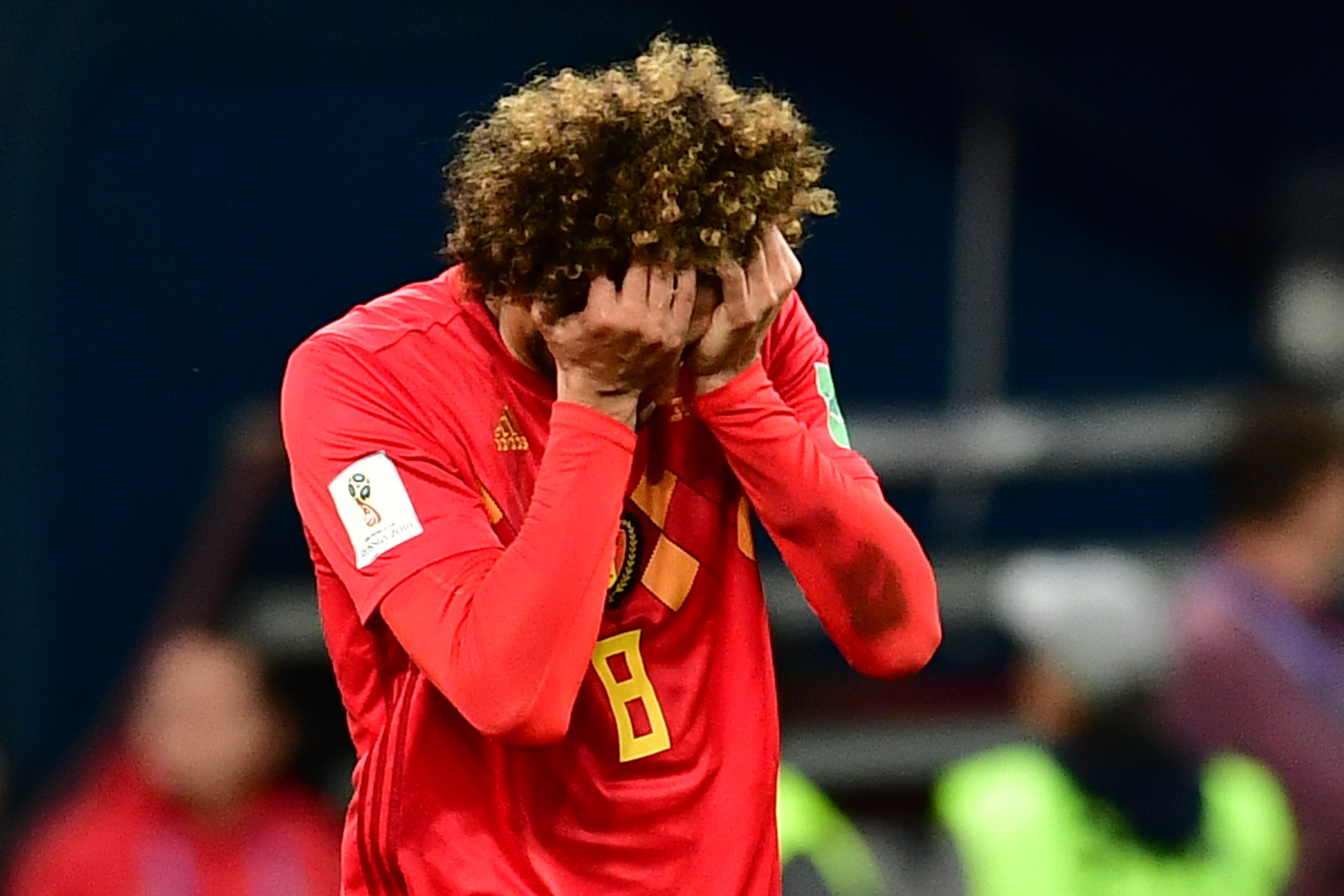 世足賽法國以1:0擊敗比利時,圖為比利時球員失望掩面。(Getty Images)