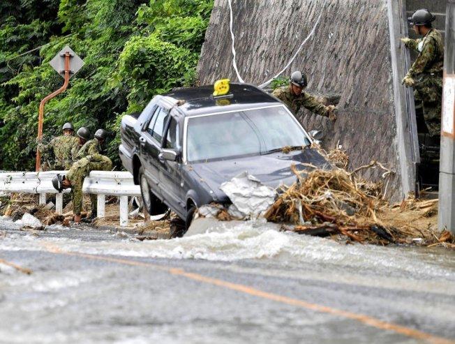 西日本受到連日破紀錄豪雨重創。 美聯社