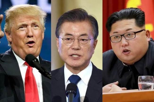 文在寅(中)說,他和北韓國務委員長金正恩(右)、美國總統川普(左)與金正恩的高峰會相繼成功,使南北韓與美國共同邁開第一步,這非常重要。(路透)