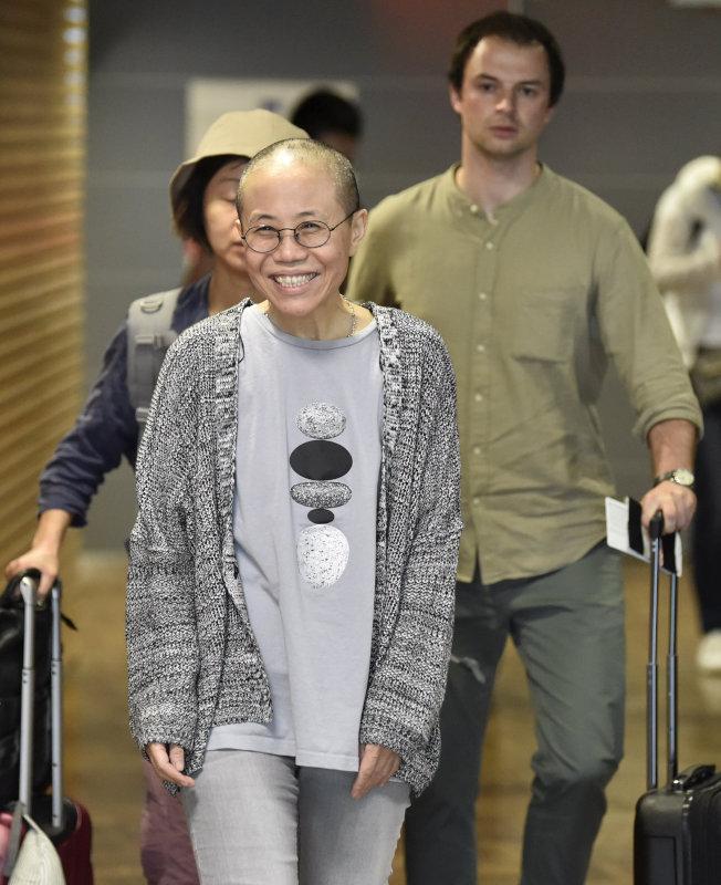 劉霞被軟禁8年後,10日搭芬蘭航空班機抵達柏林。路透