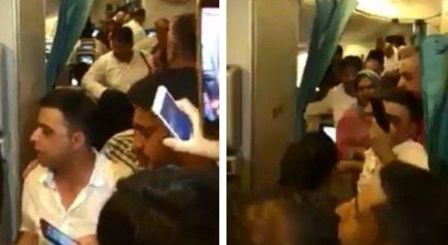 乘客熱暈要求開門,畫面十分混亂。圖擷自Facebook/The Times of Karachi