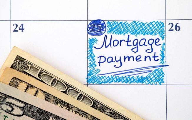 不少人都夢想在退休前能夠舉行「還清房貸派對」,不過有專家認為,付清房貸並不一定是最佳策略。(Getty Images)