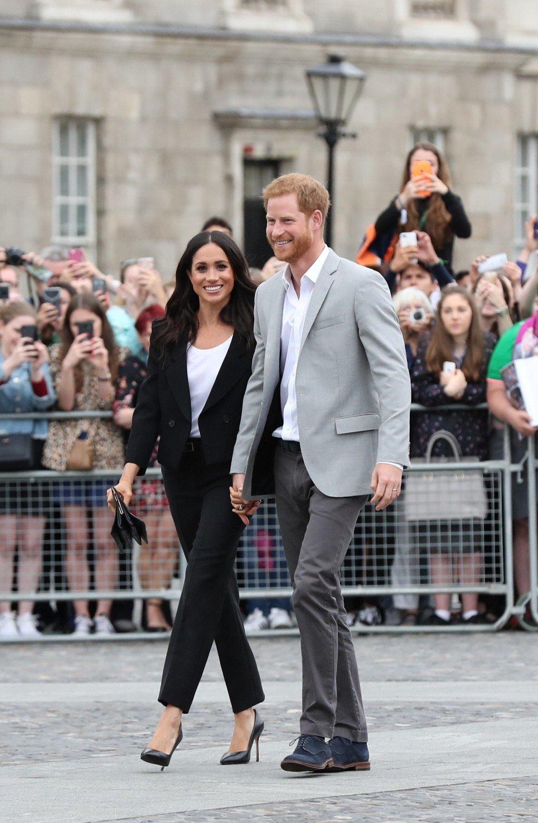 梅根和夫婿哈利王子出席活動也會選擇穿著褲裝。圖/路透資料照片
