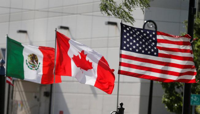 美國與墨西哥達成貿易協議後,再對加拿大施壓。(路透)
