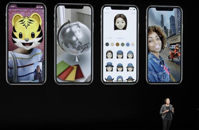 新款蘋果手機攝像功能更優化,也具有辨識人臉功能。(美聯社)
