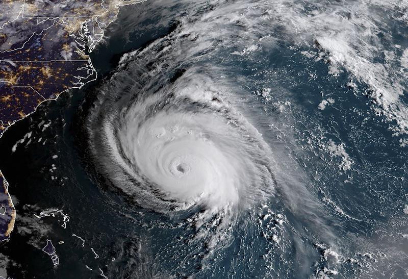 完美風暴的超級颶風「佛羅倫斯」逼近美東海岸,圖為12日美東時間早上6點的氣象衛星圖所見颶風眼及暴風半徑令人怵目驚心。Getty Images