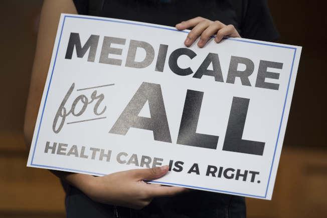 最新民調顯示,大多數美國年輕人支持全民健保。(Getty Images)