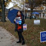 〈圖輯〉期中選舉冒雨展開 華人忙參選、投票、發傳單