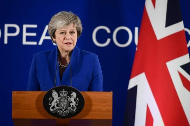 英國首相梅伊25日在布魯塞爾的歐盟特別峰會結束後的神情。(Getty Images)