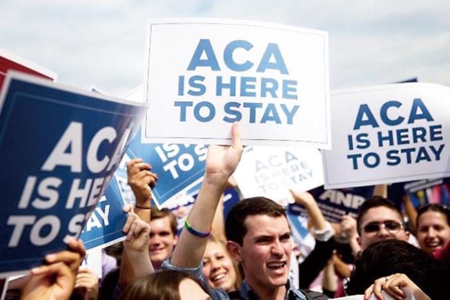 「歐記健保」(ACA, 即可負擔健保法)的支持者。(Getty Images)