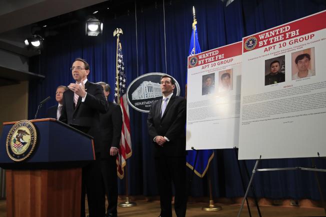 美國司法部起訴兩名受雇於中國政府的駭客,司法部副部長羅森斯坦說,駭客涉及竊取美國海軍和NASA的機密情報。(美聯社)