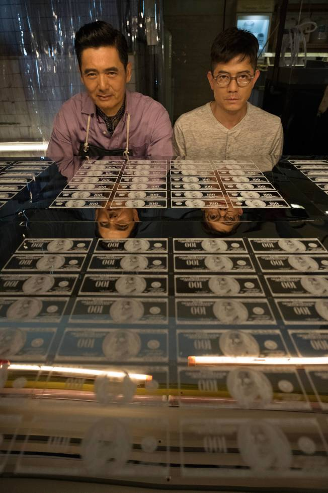 由郭富城(右)和周潤發主演的電影《無雙》,片中有大量道具美鈔。 圖:雙喜提供