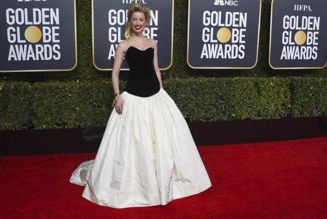 今年因为《水行侠》翻红的女星安柏赫德(Amber Heard),则是选穿Monique Lhuillier的黑白拼接蓬裙。(美联社)