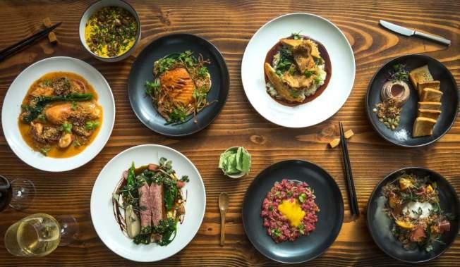 Tuome餐廳創辦人、華裔主廚陳Thomas呈現融合美式風味與亞洲菜特色的餐點。(取自官網)