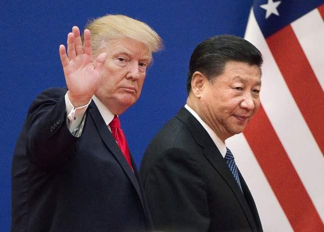 玄學家李居明預測,己亥豬年中美兩國可望步向坦途。圖為美國總統川普、中國國家主席習近平檔案照。(Getty Images)