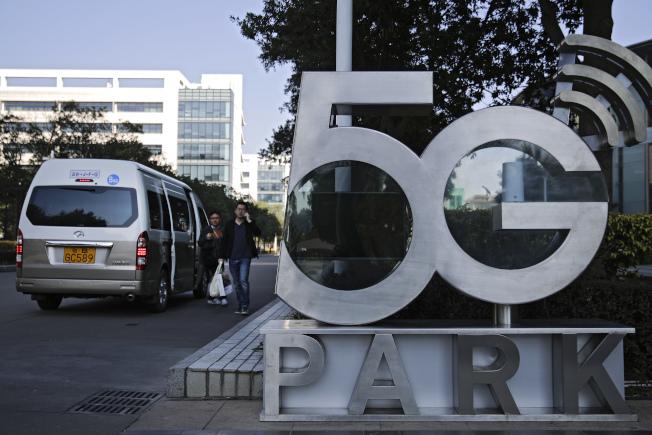北京恐為5G競賽付出沉重代價。美聯社